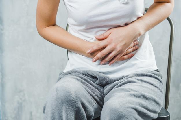 อาหาร ต้องห้าม ตอน เป็นประจำเดือน (เมนมา อย่าทาน) Close-up of a woman sitting on chair having stomach ache