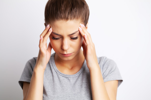 Head pain, exhausted young woman has suffering from unbearable headache Premium Photo