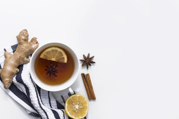 Lemon tea with spices on striped cloth Free Photo