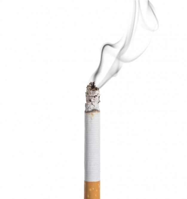 Burning cigarette on white background Free Photo