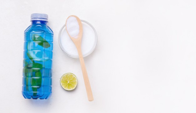 Isotonic sports drink with collagen in a blue bottle on a white background Premium Photo