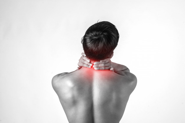 Muscular man use handles at the neck to relieve pain isolated on white background. Free Photo