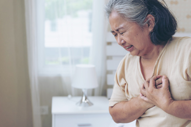 Senior female asian suffering from bad pain in his chest heart attack at home - senior heart disease Free Photo