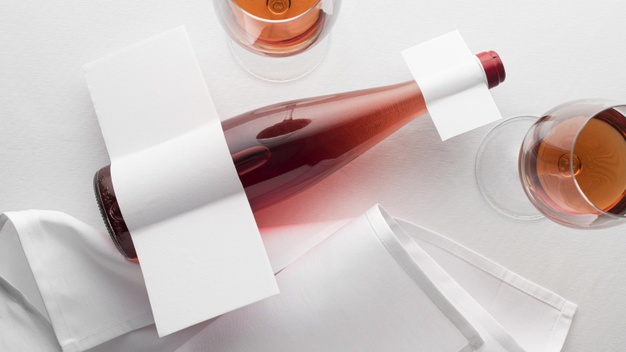 Top view of clear wine bottle and glasses with blank label Free Photo